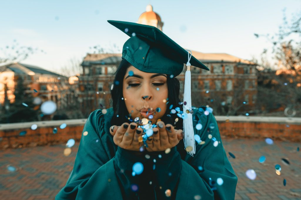 university giving days: featured image of young girl in cap and gown with confetti
